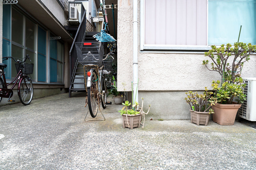 potted plants by an apartment building in Japan