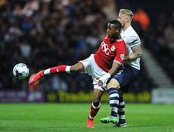 Jonathan Kodjia of Bristol City controls the ball under pressure from Tom Clarke of Preston North End - Mandatory byline: Dougie Allward/JMP - 07966386802 - 15/09/2015 - FOOTBALL - Deepdale Stadium -Preston,England - Bristol City v Preston North End - Sky Bet Championship