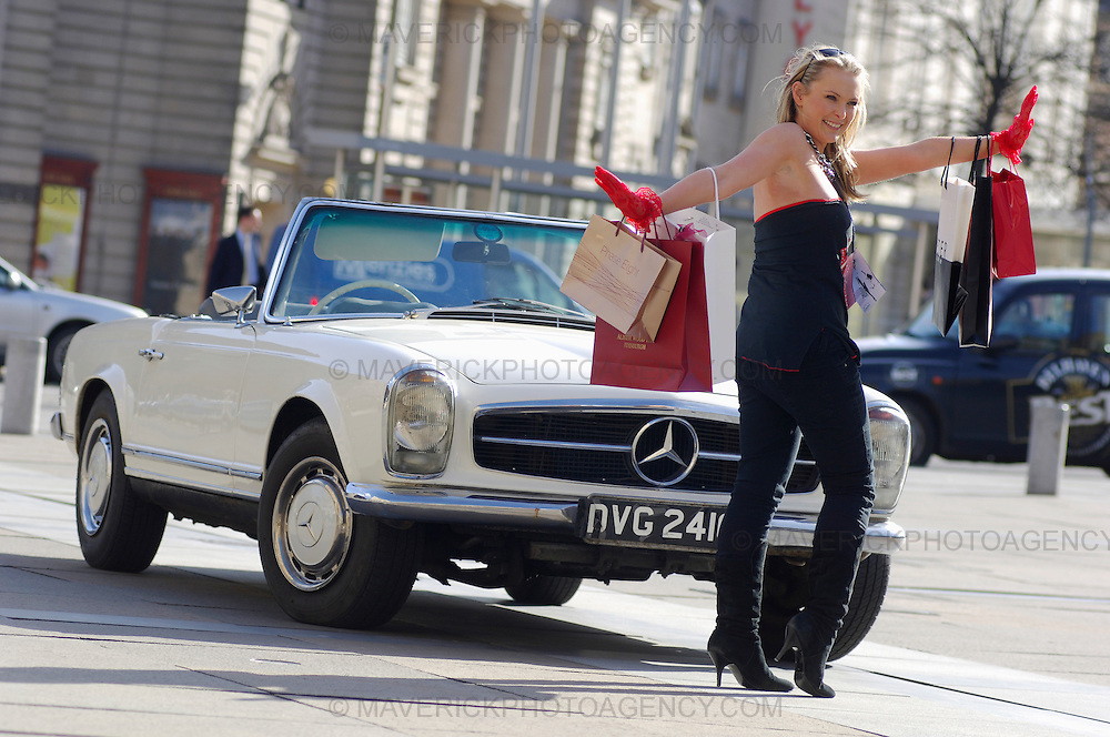 DJ Heather Suttie from XFM helps launch the Edinburgh International Fashion Festival. Pictured with an open top 1969 Mercedes 280SL and designer shopping bags.