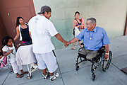 "Wapato Mayor Jesse Farias, right, greets Shon Jamie on the street while he was out with his family. ""He's always doing something nice everybody,"" says Shon, who grew up in Wapato. PHOTO BY KAI-HUEI YAU//KAIPHOTO.NET//541.221.2586"