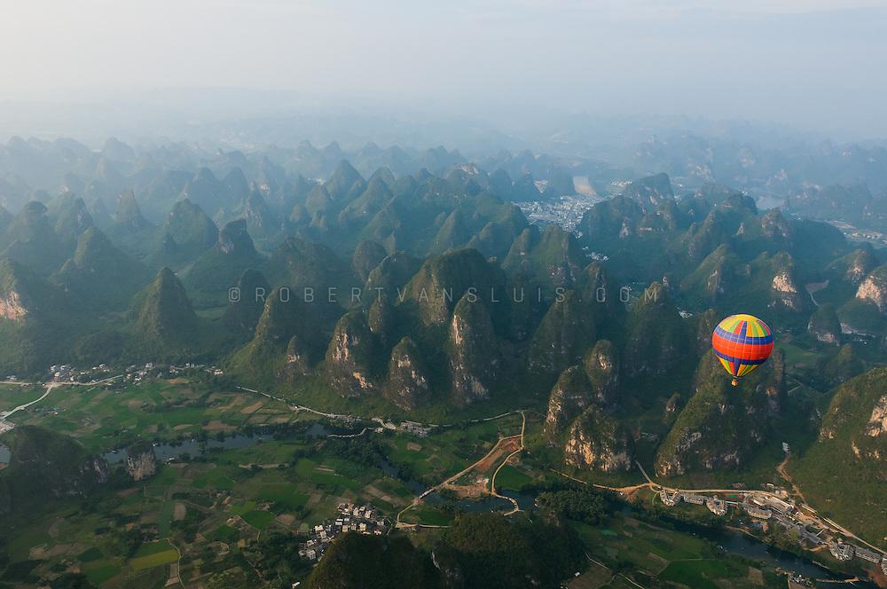 Balloon over karst mountain scenery, Yangshuo, Guangxi, China