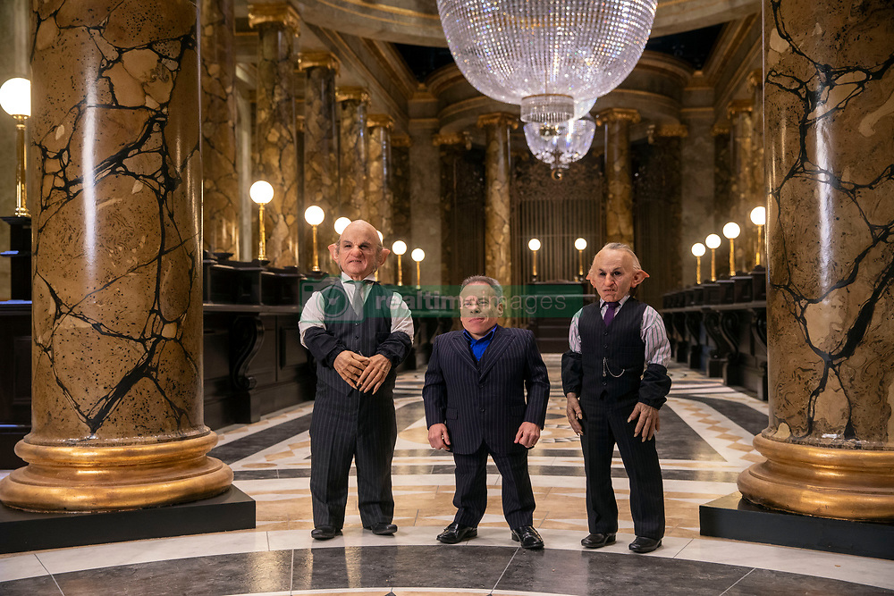 Warwick Davis (centre) at the opening of the new Gringotts Wizarding Bank expansion at the Making Of Harry Potter attraction at the Warner Bros Studio Tour, in Watford.