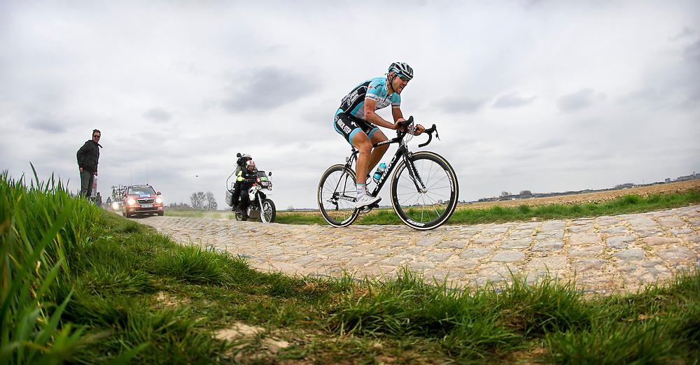 France, Camphin-en-Pévèle, 08-04-2012.<br /> Cycling, Men.<br /> From Paris to Roubaix.<br /> Tom Boonen the belgium rider on the cobble stones strip nearby Camphin-en-Pévèle on 20 k from the finish line.<br /> Photo : Klaas Jan van der Weij