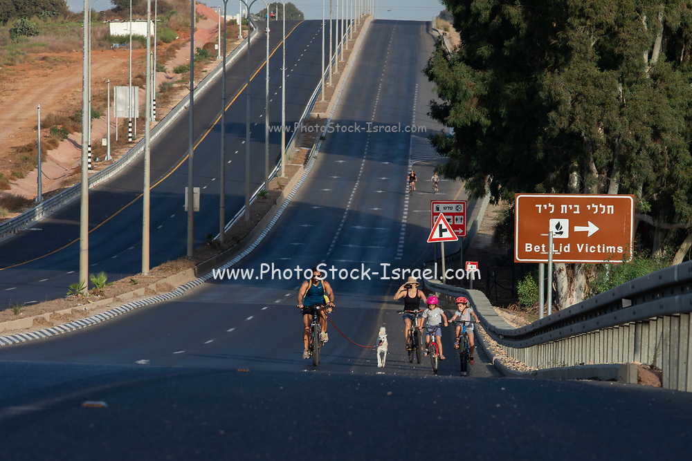 Israel, Children and families enjoy the empty streets to ride bicycles during Yom Kippur. Virtually all motorized traffic stop during the Jewish holiday on Yom Kippur