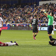 Jamison Olave, (left), New York Red Bulls and Jackson, Toronto FC, lay on the ground after clashing heads while challenging for a ball during the New York Red Bulls Vs Toronto FC, Major League Soccer regular season match at Red Bull Arena, Harrison, New Jersey. USA. 11th October 2014. Photo Tim Clayton