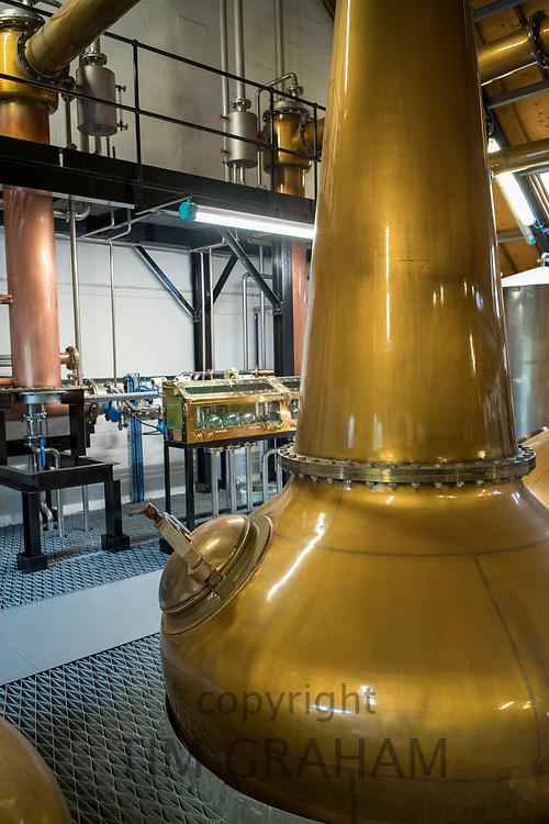 Copper pot whisky spirit still at Arran Whisky Distillery, one of the famous Scottish distilleries, at Lochranza, Isle of Arran, Scotland