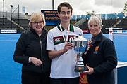 Surbiton's Ben Park accepts the trophy. Surbiton v Beeston - Boys U18 Cup Final, Lee Valley Hockey & Tennis Centre, London, UK on 01 May 2017. Photo: Simon Parker