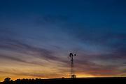 Aeromotor windmill against red sky, England, United Kingdom
