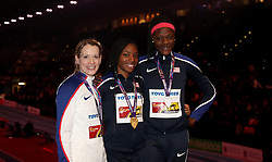 Great Britain's bronze medal winner Eilidh Doyle (left), USA's silver medal winner Shakima Wimbley (right) and USA's gold medal winner Courtney Okolo (centre) after the 400m Final during day three of the 2018 IAAF Indoor World Championships at The Arena Birmingham.