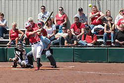 19 April 2014:  Sara Bradley bats in front of catcher Kacey Rogers during an NCAA women's softball game between the Evansville Purple Aces and the Illinois State Redbirds on Marian Kneer Field in Normal IL