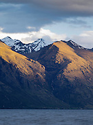 Sunset view of Wye Creek, looking across Lake Wakatipu, from just north of Queenstown, Otago, New Zealand
