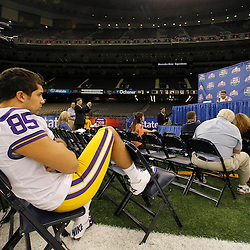 January 6, 2012; New Orleans, LA, USA; LSU Tigers long snapper Alex Russian (85) watches as cornerback Tyrann Mathieu (7) talks to the media during Media Day for the 2012 BCS National Championship game to be played on January 9, 2012 against the Alabama Crimson Tide at the Mercedes-Benz Superdome.  Mandatory Credit: Derick E. Hingle-US PRESSWIRE