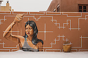 A mural on an adobe wall at the Museum of Contemporary Native Arts in the historic district during a winter snowfall December 12, 2015 in Santa Fe, New Mexico.
