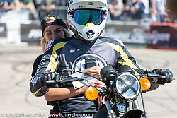Husqvarna stunter performing during the Revival and Roland Sands sponsored races in the parking lot of the Austin American Statesman outside the Handbuilt Show. Austin, Texas USA. Saturday, April 13, 2019. Photography ©2019 Michael Lichter.