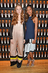 Left to right, LILY COLE and NAOMIE HARRIS at the Cointreau Creative Crew Award at Liberty, Great Marlborough Street, London on 24th May 2016.
