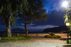 Sorrento, Italy, September 13 2017. With the terrace of the Grand Hotel Ambasciatore lit up in the foreground, and Mt Vesuvio across the bay of Naples, photographed on an early morning walkabout in Sorrento, Italy. © Paul Davey
