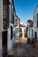 Residents walk the cobblestone streets of Ronda, a white hill town in the Andalusian region of Southern Spain.