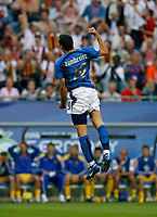 Photo: Glyn Thomas.<br />Italy v Ukraine. Quarter Finals, FIFA World Cup 2006. 30/06/2006.<br /> Italy's Gianluca Zambrotta celebrates after giving his side an early 1-0 lead.