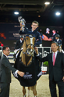 Bertram Allen on Quiet Easy 4 receives the winner's trophy from the hands of Mr. Michael Lee (left) and Dr Simom S O IP (right) at the end of Hong Kong Jockey Club Trophy during the Longines Masters of Hong Kong on 19 February 2016 at the Asia World Expo in Hong Kong, China. Photo by Juan Manuel Serrano / Power Sport Images