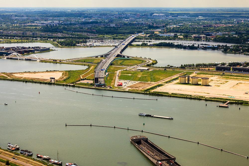 Nederland, Noord-Holland, Amsterdam, 14-06-2012; Buiten-IJ met ring A10 en Zeeburger tunnel, eiland Zeeburg (zeeburger eiland). De tunnel verbindt Amsterdam-Noord met de rest van Amsterdam. In de industriële silo's (voormalige waterzuiveringsinstallatie) op Zeeburg wordt het Annie M.G. Schmidt Huis gevestigd..Zeeburgertunnel (tunnel) connecting  the north and the south of Amsterdam and the Zeeburgereiland (isle) in between..luchtfoto (toeslag), aerial photo (additional fee required).foto/photo Siebe Swart