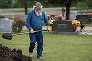 WEST, TEXAS - APRIL 17:  Jake Sulak digs a grave at the St Mary's Catholic Cemetery in West, Texas on April 17, 2017. (Photo by Cooper Neill for The Washington Post)