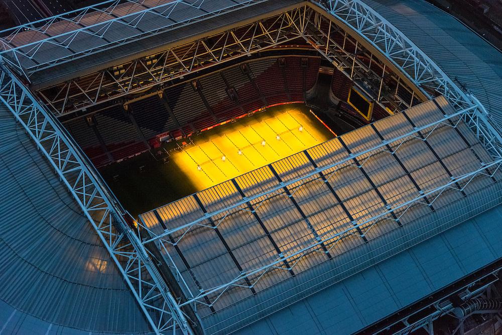 Nederland, Noord-Holland, Amsterdam, 16-01-2014; Amsterdam Zuidoost,  stadion Arena. Dak van het stadion is geopend, het gras van het voetbaldveld wordt belicht door speciale groeilampen.<br /> Amsterdam Zuidoost, Arena Ajax Stadium. The stadium roof is open, the grass of the football field is lighted using special grow lights.<br /> luchtfoto (toeslag op standaard tarieven);<br /> aerial photo (additional fee required);<br /> copyright foto/photo Siebe Swart.