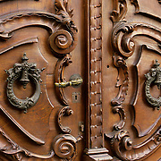 South America, Uruguay, Montevideo. Traditional wooden doors and brass handles.