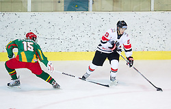 Emilio Romig of Austria vs Mauras Baltrukonis of Lithuania  during the ice hockey match between National teams of Lithuania (LTU) and Austria (AUT) at 2011 IIHF World U20 Championship Division I - Group B, on December 12, 2010 in Ice skating Arena, Bled, Slovenia.  (Photo By Vid Ponikvar / Sportida.com)