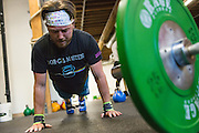 Cody Fowler of San Jose completes a circuit of pushups during a CrossFit program at ThirdSpace Fitness in San Jose, California, on July 6, 2015. (Stan Olszewski/SOSKIphoto for Content Magazine)