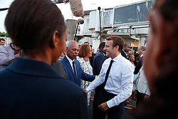 France's President Emmanuel Macron is greeted by officials on the tarmac of Pointe-a-Pitre airport, upon his arrival in the Guadeloupe island, the first step of his visit to French Caribbean islands, Tuesday, Sept. 12, 2017. (AP Photo/Christophe Ena, Pool)