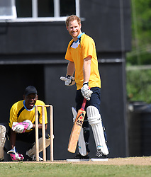 Prince Harry during an exhibition cricket match at the Daren Sammy Cricket Ground on the island of St Lucia during the second leg of his Caribbean tour.
