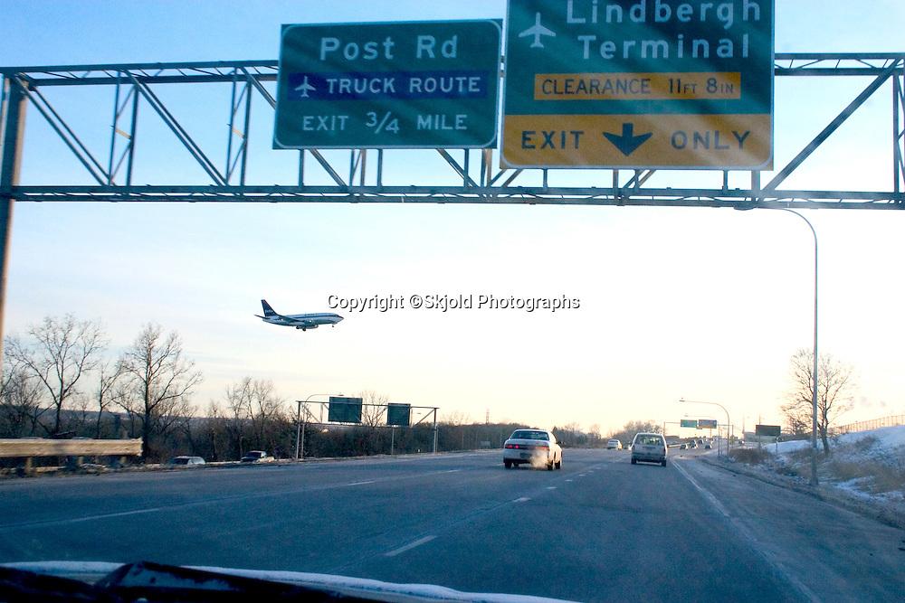 Delta airline airplane flying over Freeway 494 approaching Minneapolis-St. Paul International Airport Charles Lindbergh Terminal runway.   Minneapolis Minnesota USA