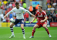 Preston North End's Paul Gallagher under pressure from Middlesbrough's Grant Leadbitter<br /> <br /> Photographer Kevin Barnes/CameraSport<br /> <br /> Football - The Football League Sky Bet Championship - Preston North End v Middlesbrough -  Sunday 9th August 2015 - Deepdale - Preston<br /> <br /> © CameraSport - 43 Linden Ave. Countesthorpe. Leicester. England. LE8 5PG - Tel: +44 (0) 116 277 4147 - admin@camerasport.com - www.camerasport.com