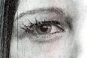 newspaper print with the close up a woman eye
