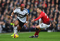 Football - 2018 / 2019 Premier League - Fulham vs. Manchester United<br /> <br /> Fulham's Ryan Babel holds off the challenge from Manchester United's Diogo Dalot, at Craven Cottage.<br /> <br /> COLORSPORT/ASHLEY WESTERN