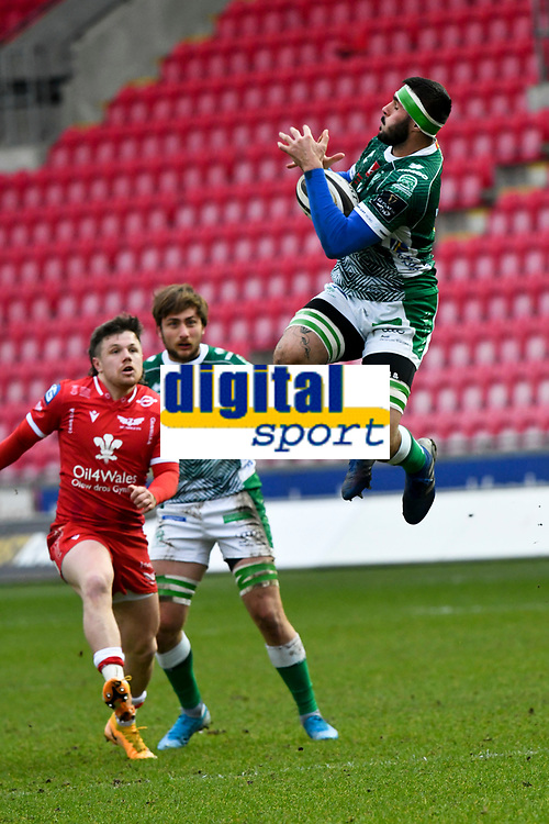 Rugby Union - 2020 / 2021 Guinness PRO14 - Round 12 - Scarlets vs Benetton - Parc-y-Scarlets<br /> <br /> Riccardo Favretto of Benetton leaps to take the ball from a kick off<br /> <br /> COLORSPORTWINSTON BYNORTH