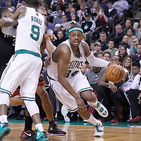 01 April 2012: Boston Celtics small forward Paul Pierce (34) drives past Miami Heat point guard Norris Cole (30) on a screen set by Boston Celtics point guard Rajon Rondo (9) during the Boston Celtics 91-72 victory over the Miami Heat at the TD Banknorth Garden, Boston, Massachusetts, USA. NOTE TO USER: User expressly acknowledges and agrees that, by downloading and or using this photograph, User is consenting to the terms and conditions of the Getty Images License Agreement. Mandatory Credit: 2012 NBAE (Photo by Chris Elise/NBAE via Getty Images)