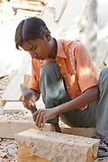 A stone mason carving in Jaisalmer, Rajasthan, India