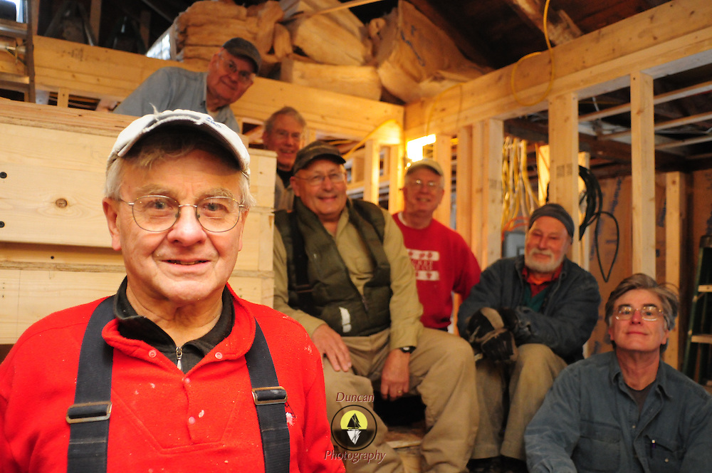 WEST BATH, Maine -- 1/31/14 -- Gerry Brookes, left, poses with his crew of fellow volunteers at a house in West Bath. Brookes spent 30 years as an English professor at the University of Nebraska. Since retiring to Maine, he has helped out on 20 different properties as a Habitat for Humanity volunteer. Photo by Roger S. Duncan for the Forecaster.