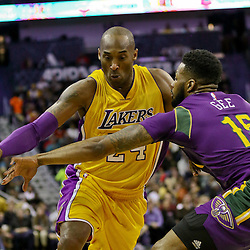 Feb 4, 2016; New Orleans, LA, USA; Los Angeles Lakers forward Kobe Bryant (24) drives past New Orleans Pelicans forward Alonzo Gee (15) during the first quarter of a game at the Smoothie King Center. Mandatory Credit: Derick E. Hingle-USA TODAY Sports