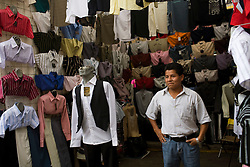 People shop in the huge street market in Tepito, a dangerous neighborhood in Mexico City, on Wednesday, October 28, 2009.  The informal economy makes up a significant part of the Mexican economy, though one of businesses in the informal economy pay taxes.