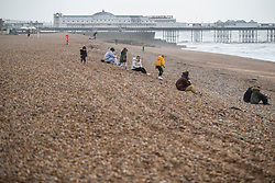 © Licensed to London News Pictures. 20/02/2021. Brighton, UK. Only a handful of people can be seen on the beach in Brighton and Hove as the Corona Virus Lockdown continues across the United Kingdom. Photo credit: Hugo Michiels/LNP