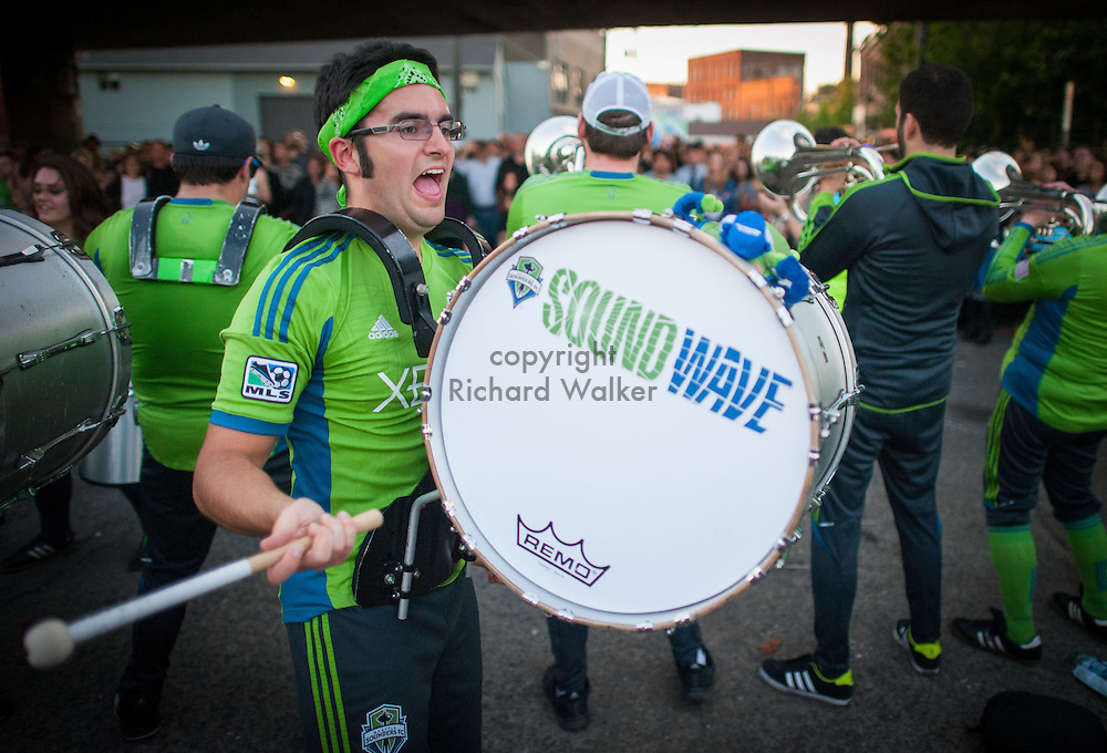 2013 June 21 - A bass drummer with Seattle Sounders FC Sound Wave Band performs during Honk! Fest West 2013 in Georgetown, Seattle, WA. By Richard Walker