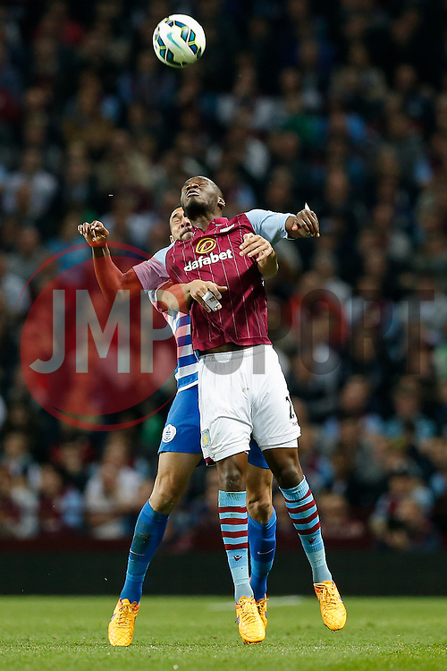 Christian Benteke of Aston Villa heads the ball - Photo mandatory by-line: Rogan Thomson/JMP - 07966 386802 - 07/04/2015 - SPORT - FOOTBALL - Birmingham, England - Villa Park - Aston Villa v Queens Park Rangers - Barclays Premier League.