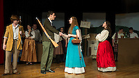 """Jeff Douglas (John Hammond), Tommy Albright (Michael O'Brien ), Fiona MacLaren (Brittney Pond) and Meg Brockie (Emily Paronto) during dress rehearsal for """"Brigadoon"""" at Laconia High School Wednesday afternoon.  (Karen Bobotas/for the Laconia Daily Sun)"""