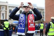 a Fan with Chelsea vs Arsenal scarf takes a picture of Stamford Bridge from his Apple iPhone. Premier league match, Chelsea v Arsenal at Stamford Bridge in London on Saturday 4th February 2017.<br /> pic by John Patrick Fletcher, Andrew Orchard sports photography.