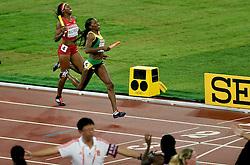 30-08-2015 CHN: IAAF World Championships Athletics day 9, Beijing<br /> De Amerikaanse Allyson Felix en haar teamgenotes Sanya Richards-Ross, Natasha Hastings en Francena McCorory lieten zich in de finale van de 4x400 meter verrassen door Jamaica, Novlene Williams-Mills<br /> Photo by Ronald Hoogendoorn / Sportida