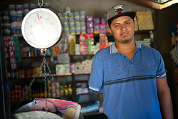 Eduard Mena, Valle de Siria, Honduras. Eduard migrated to the US and lost his arm in an accident on the train known as La Bestia in Mexico. On a subsequent journey he reached the US but was deported back to Honduras. He has been helped to set up a small business by the Lutheran World Federation with support from ELCA.