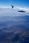 Fly over blue ridges of coastal desert hills between Lima and Cuzco, Peru, South America. Coastal Peru is one of the driest deserts on earth, watered only by rivers descending from the Andes mountains. Published in a poster addressing altitude sickness, by a medical student at USC, for use at an international health conference.