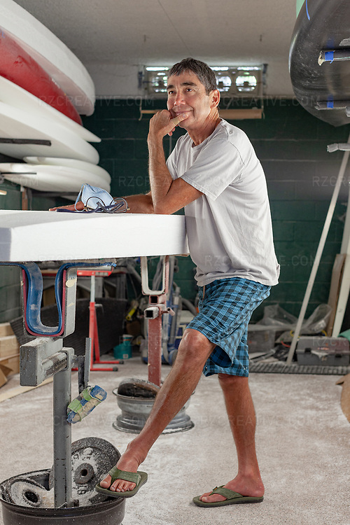 Portrait of surfer Gerry Lopez at Ron House's shaping room in San Clemente, Calif. Photo © Robert Zaleski / rzcreative.com<br /> —<br /> To license this image contact: robert@rzcreative.com